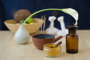 An arrangement of spice, oil and massaging tools used in Ayurved